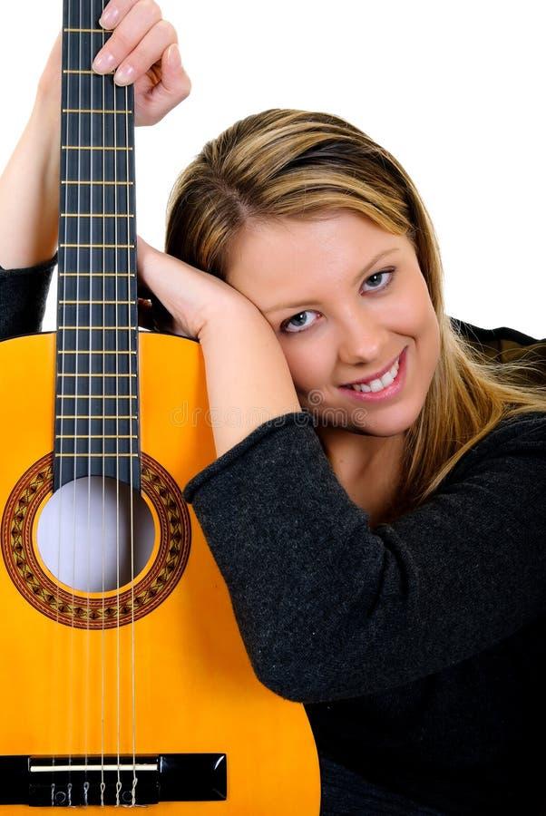 Guitare de musique de femme photographie stock