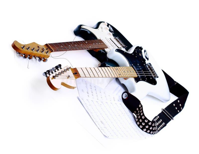 Guitares électriques d'isolement sur le blanc images libres de droits