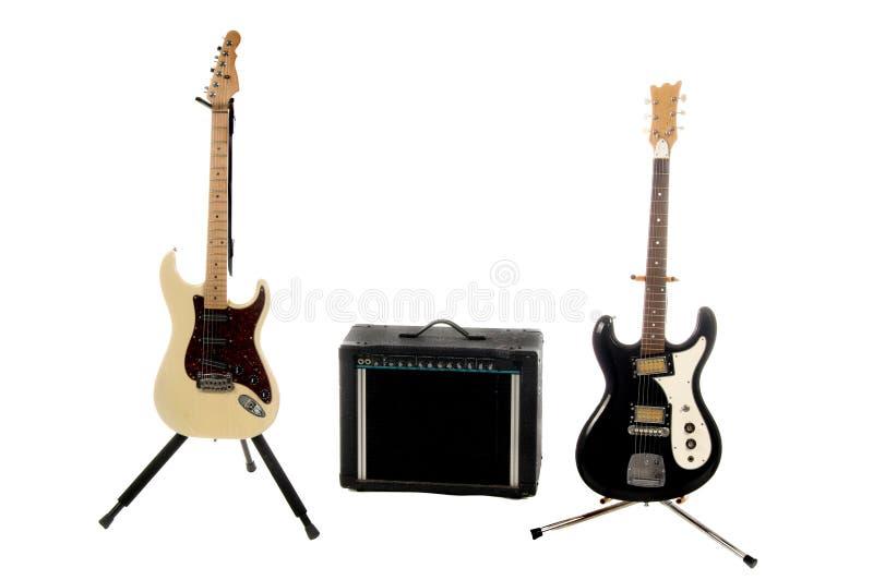 Guitares électriques et ampère photos libres de droits