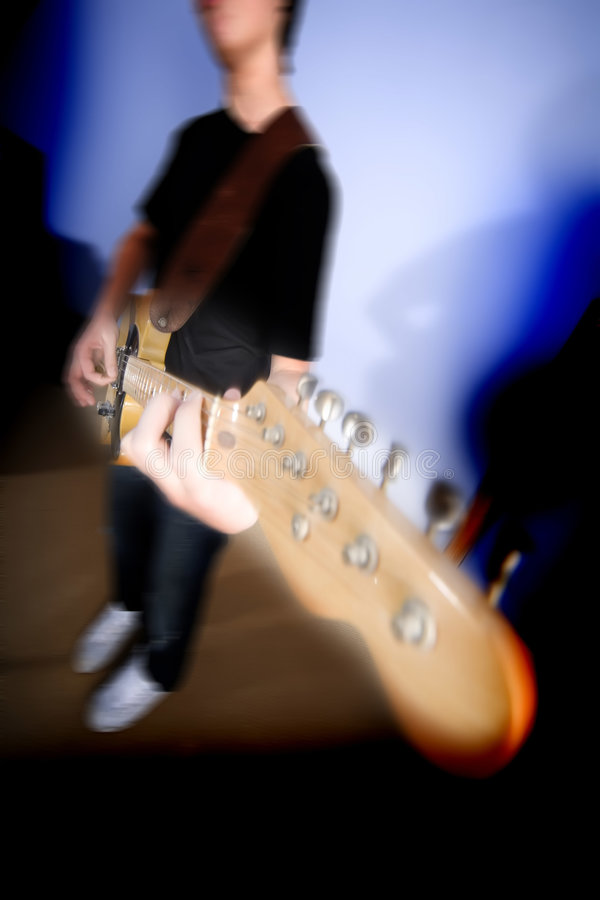 Guitarist. 14 year old teenage boy playing punk rock on a vintage blonde fender telecaster type guitar in rehearsal room on performing arts course stock photos