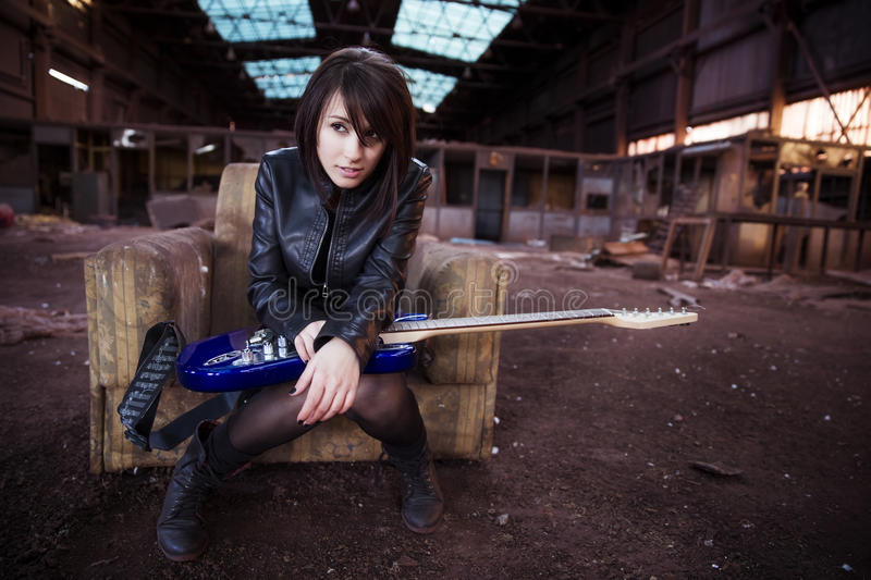 Guitarist on abandoned building royalty free stock images