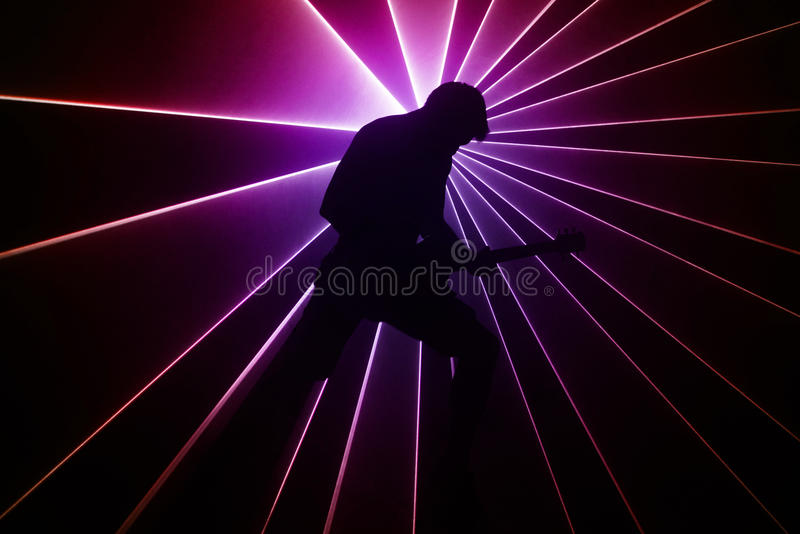 Guitarist on a background of lights royalty free stock photo