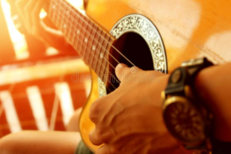 Guitarist for background, soft and blur sunset. royalty free stock image