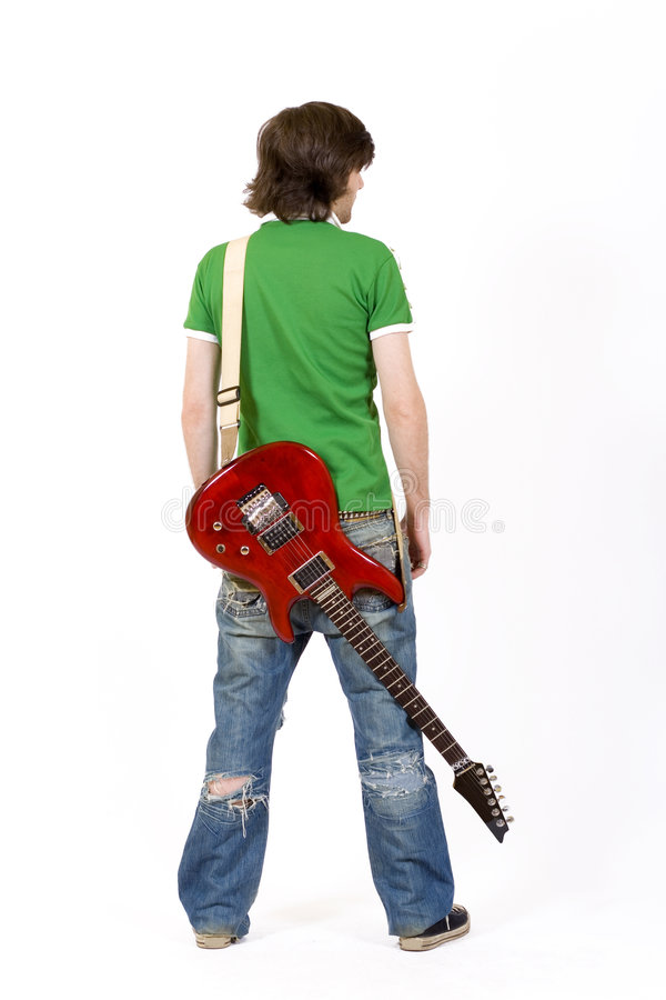 Guitarist with guitar on back stock photos