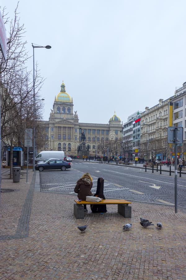 Guitarist with guitar sitting on bench in Prag royalty free stock photos
