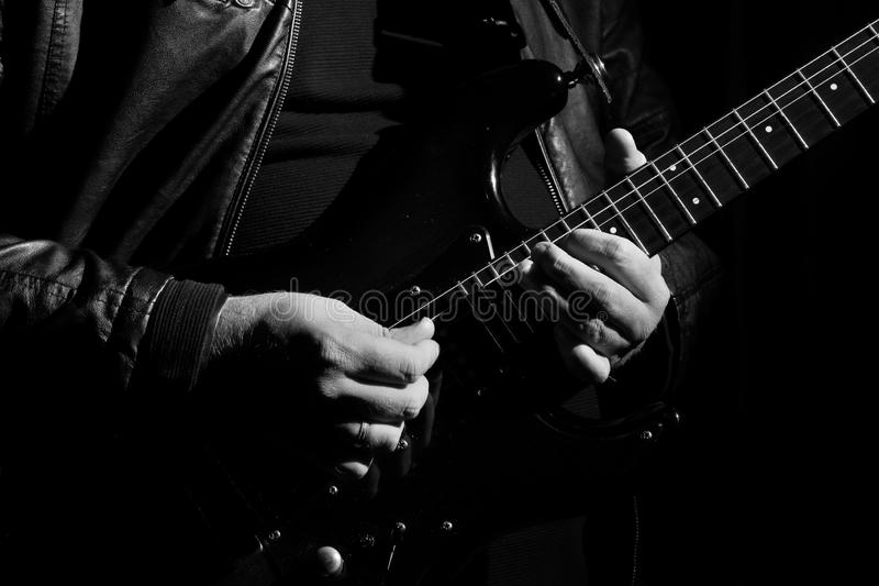 Guitarist hands stock image