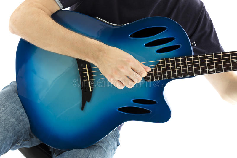 Guitarist with his blue electroacoustic guitar on white background stock photography