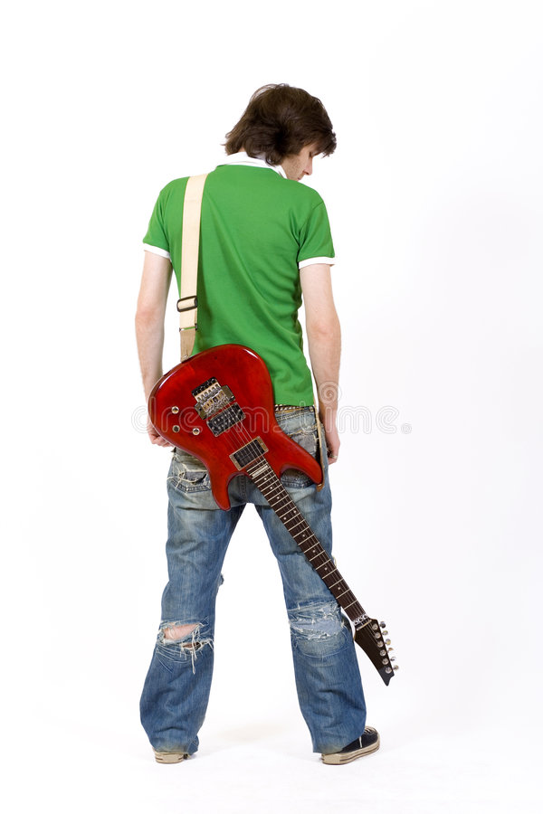 Guitarist with his guitar on back royalty free stock image