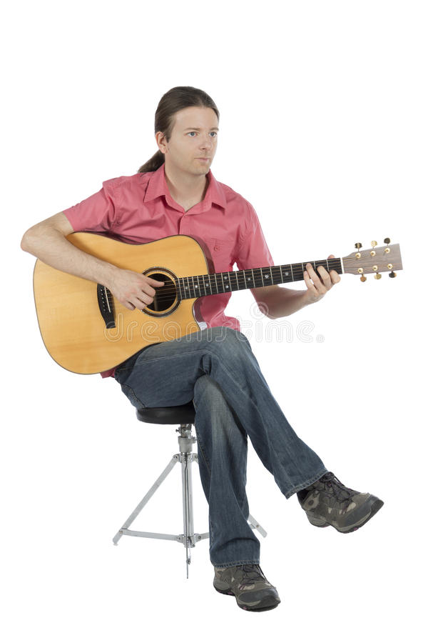 Guitarist with his guitar, portrait view stock image