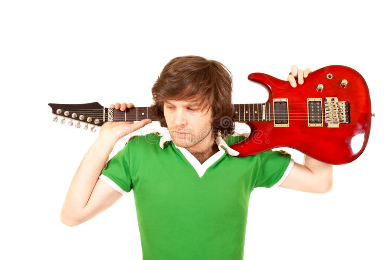 Guitarist with his guitar on shoulder royalty free stock images