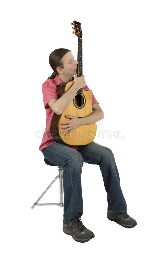 Guitarist holding his acoustic guitar, isolated stock images