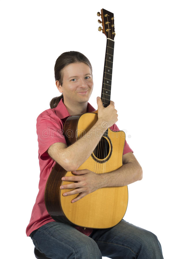 Guitarist holding his guitar royalty free stock photos