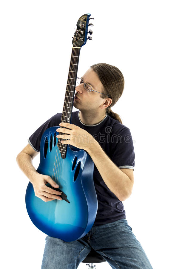 Guitarist kissing his e-guitar royalty free stock photos