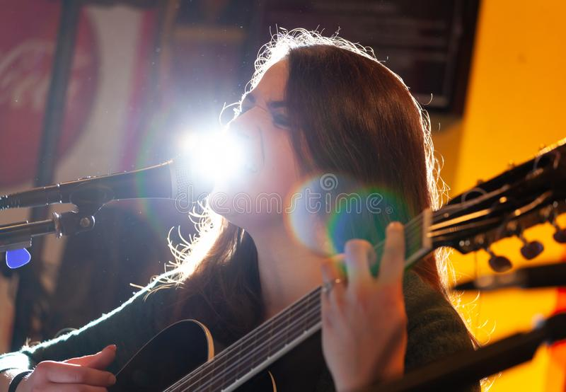 Guitarist during a musical performance. Portrait of a young guitarist during a musical performance stock images