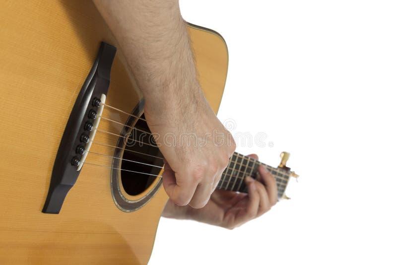 Guitarist playing acoustic guitar, closeup stock photography