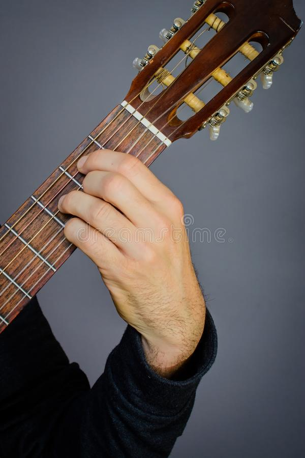 B7b5 Chord Played By Guitarist On Classical Acoustic Guitar Stock