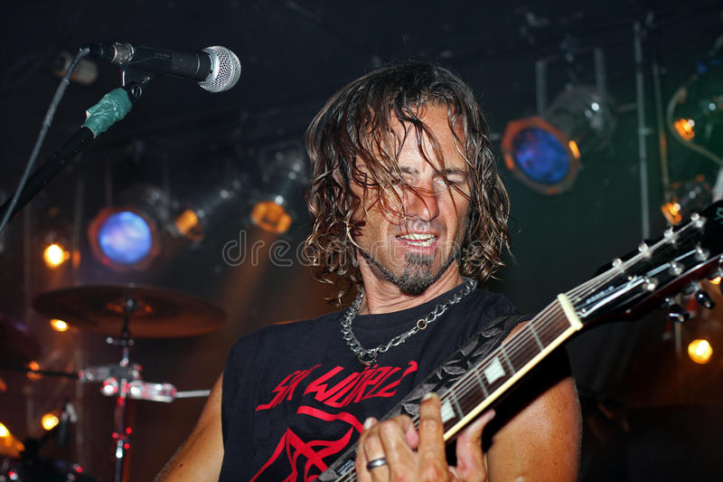 Guitarist playing in a band royalty free stock photos