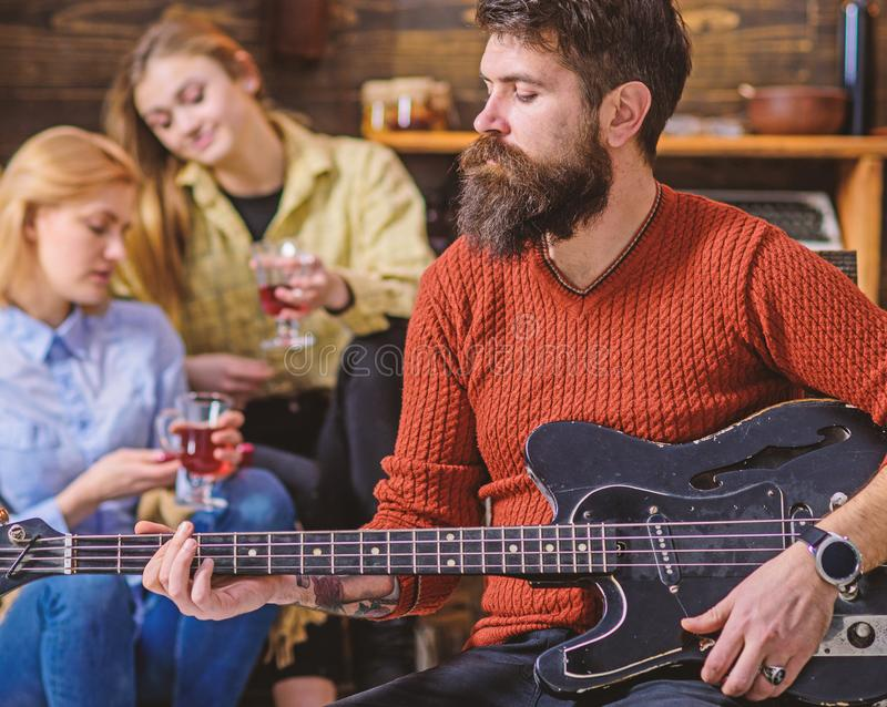 Guitarist playing at birthday, celebration concept. Bearded man performing guitar solo. Man with stylish beard. Guitarist playing at birthday, celebration royalty free stock photos