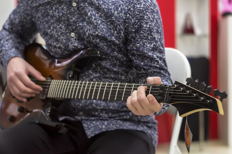 Guitarist playing electric guitar, close-up. royalty free stock photography
