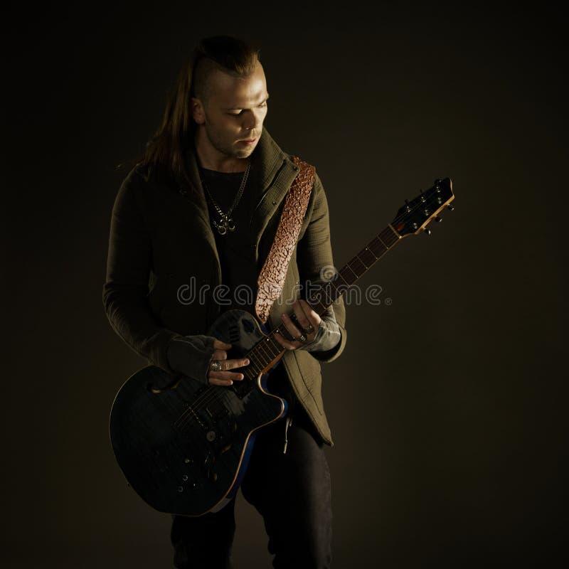 Guitarist playing rock music. stock photos