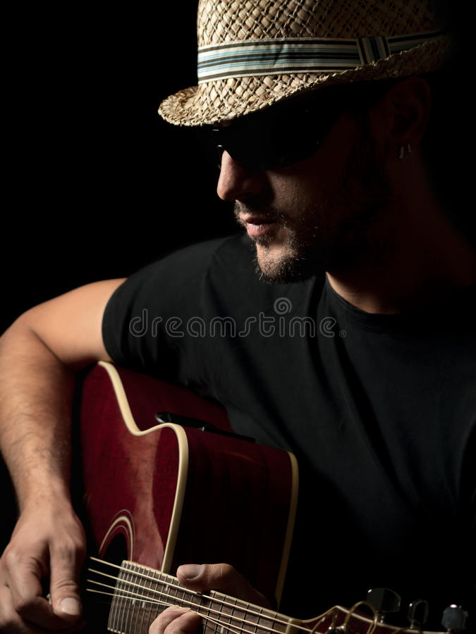 Guitarist playing solo on the acoustic guitar stock photo