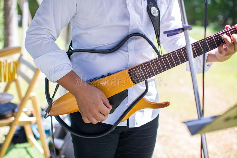 Guitarist plays.chord on an electric guitar.Close up of an electric guitar being played.  stock photos