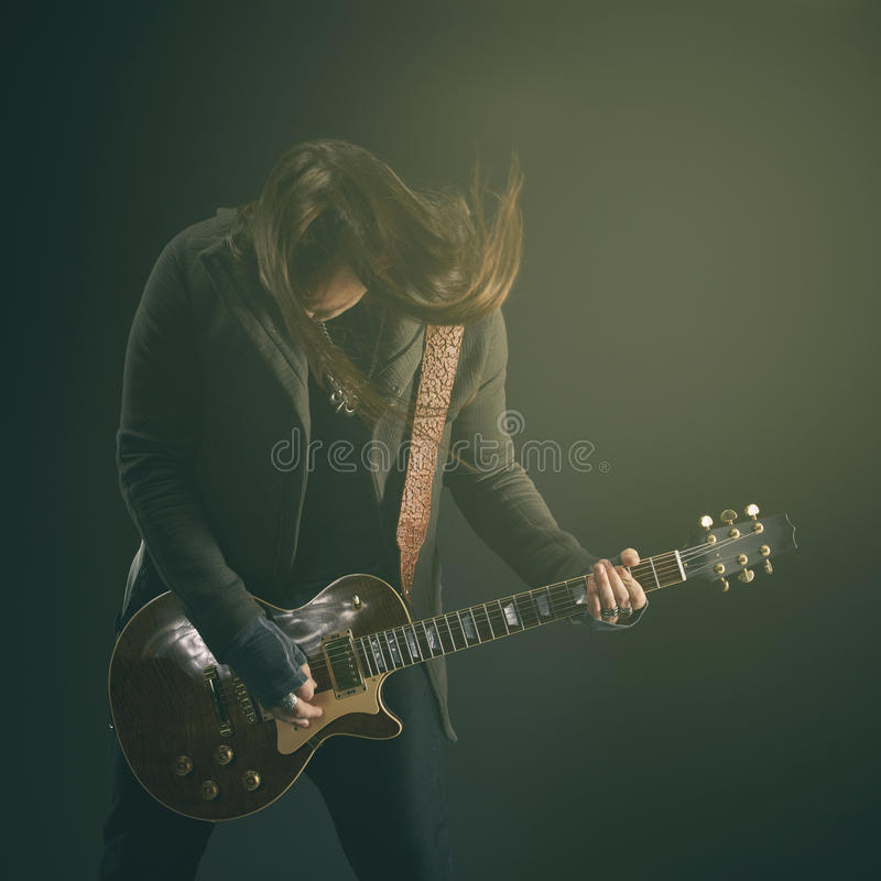 The guitarist plays solo. stock photos