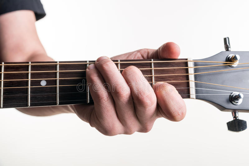 The Guitarists Hand Clamps The Chord C On The Guitar On A White