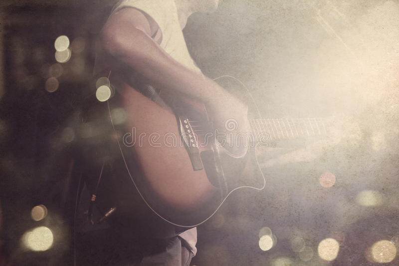 Guitarist on stage grunge background, vintage and retro color tone. Concept royalty free stock images