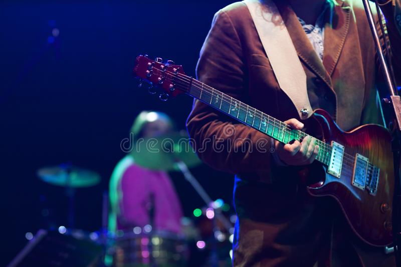 guitarist on stage - summer music festival stock photo