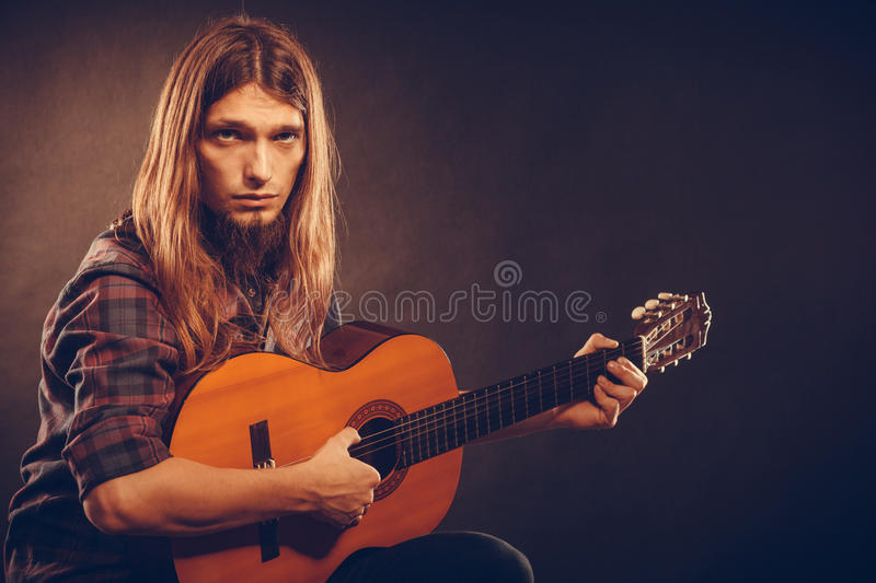 Guitarist trying out chords. royalty free stock photo