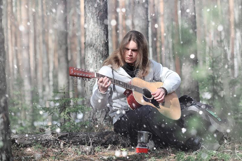 Guitarist in the woods at a picnic. A musician with an acoustic stock photos