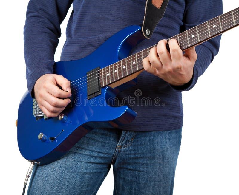 Guitariste d'isolement photo stock