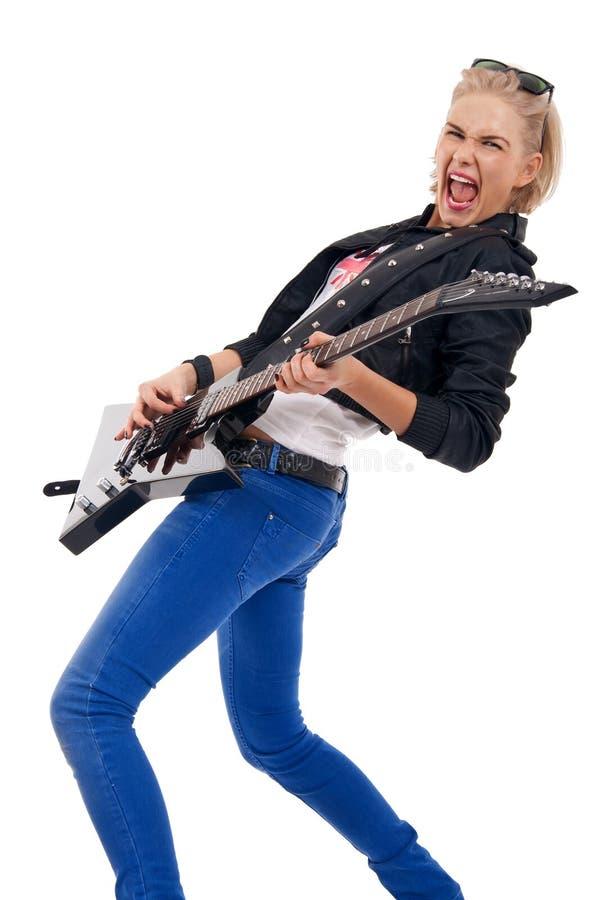 Guitariste passionné de fille image libre de droits
