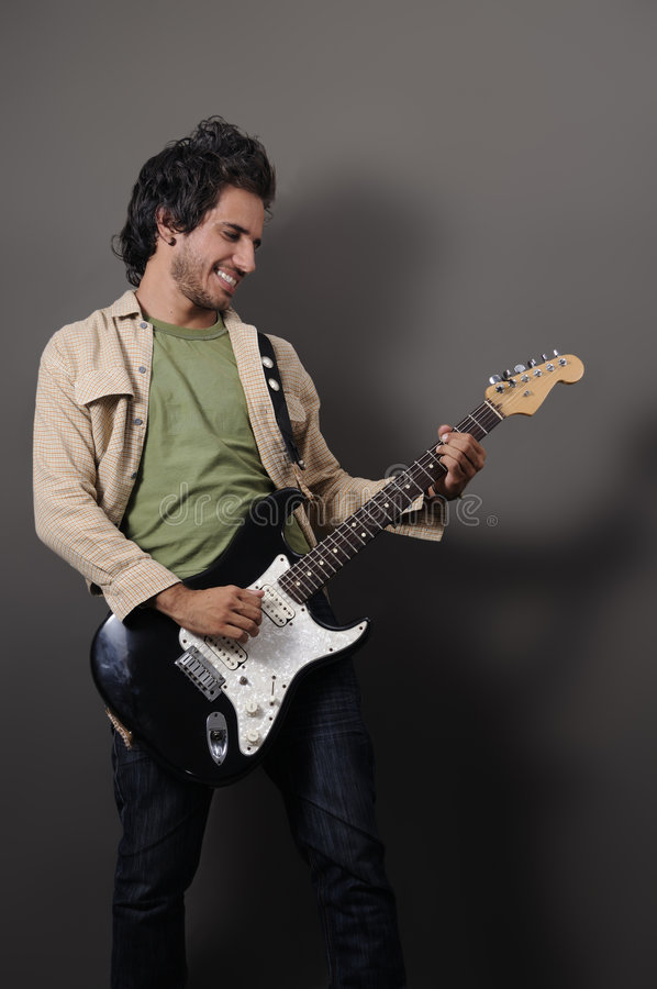 Guitariste sexy photographie stock