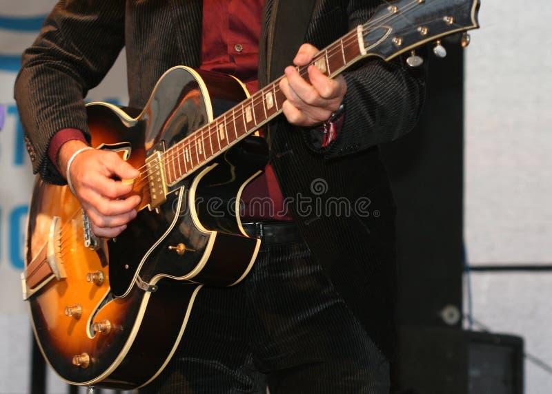 Download Guitarplayer stock photo. Image of jacket, hand, temper - 1719524