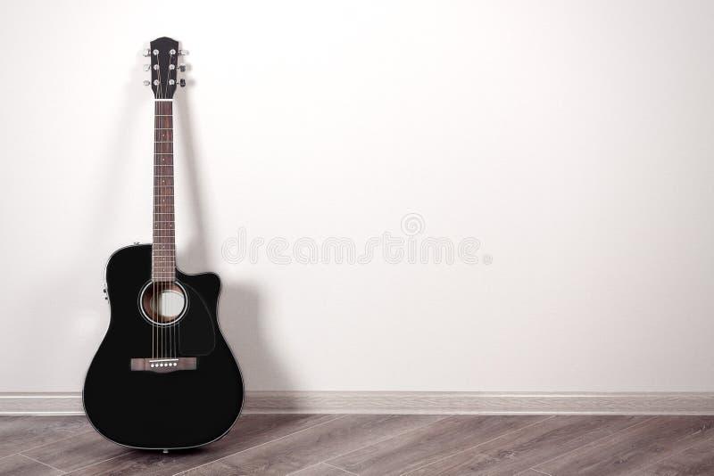 Guitarra acústica clássica preta em uma sala vazia com espaço da cópia fotografia de stock royalty free