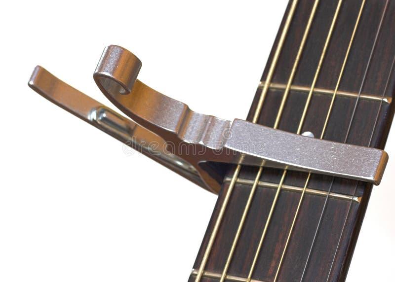 Guitarra acústica com Capo fotografia de stock