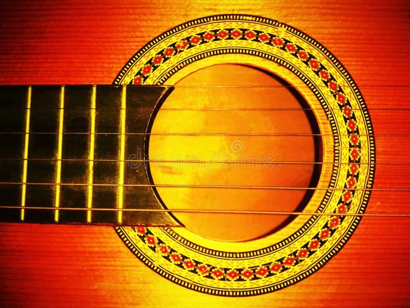Guitarra de madera, gran contraste y saturación imagen de archivo libre de regalías
