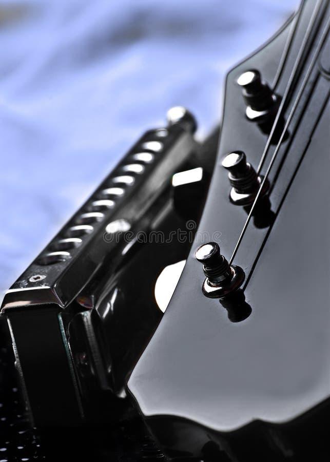 Guitarra e harmónico fotografia de stock