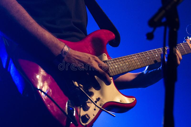 a guitarra elétrica, um instrumento global imagens de stock royalty free