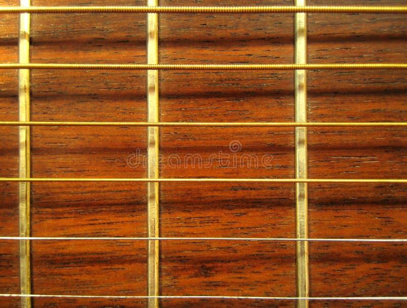 Guitarra - teste padrão de Fretboard fotografia de stock royalty free