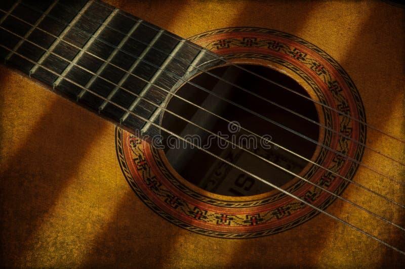 Guitarra y luz de nylon de la secuencia foto de archivo libre de regalías
