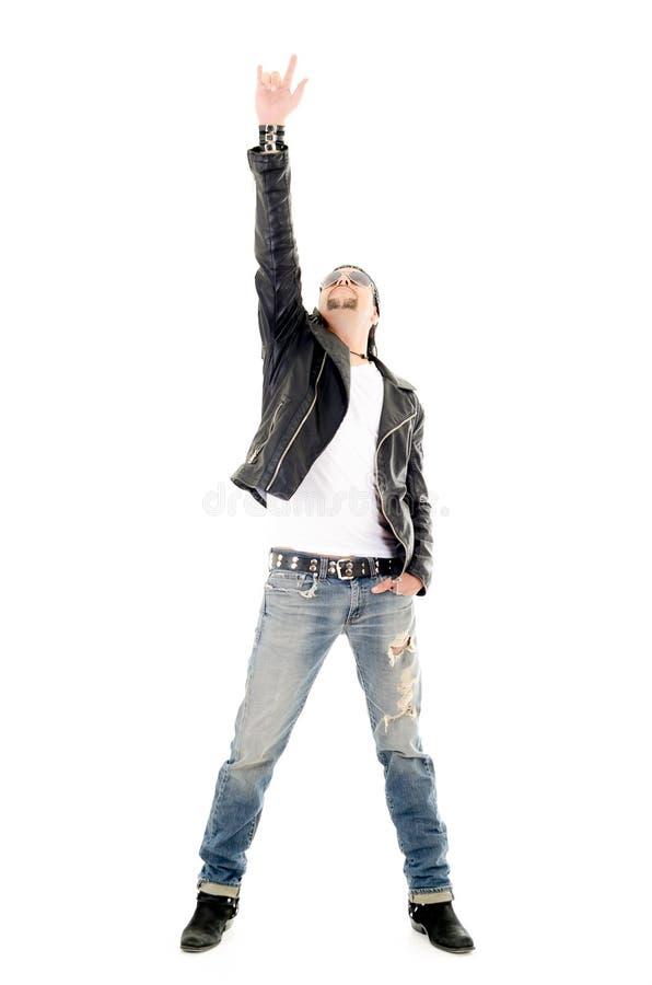 Estrella de metales pesados que hace un gesto del rock-and-roll foto de archivo