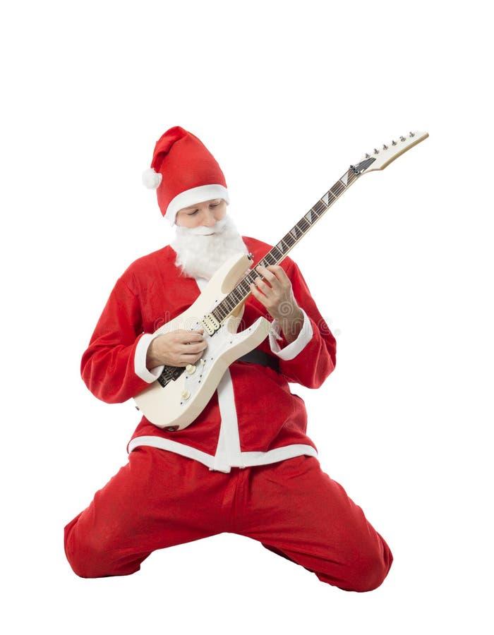Guitarrista do homem do Natal fotografia de stock royalty free