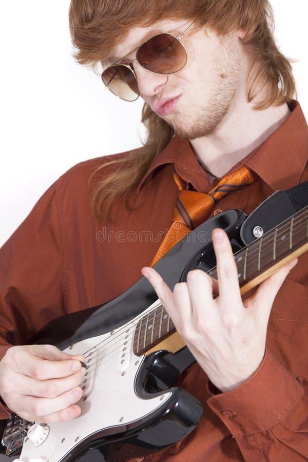 Guitarrista masculino fotos de archivo libres de regalías