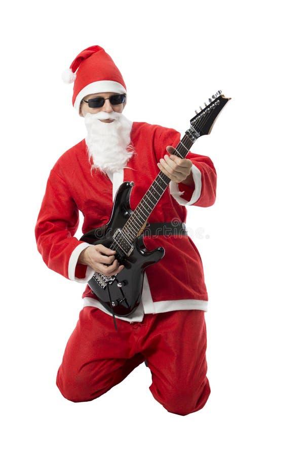 Guitarrista Santa imagem de stock
