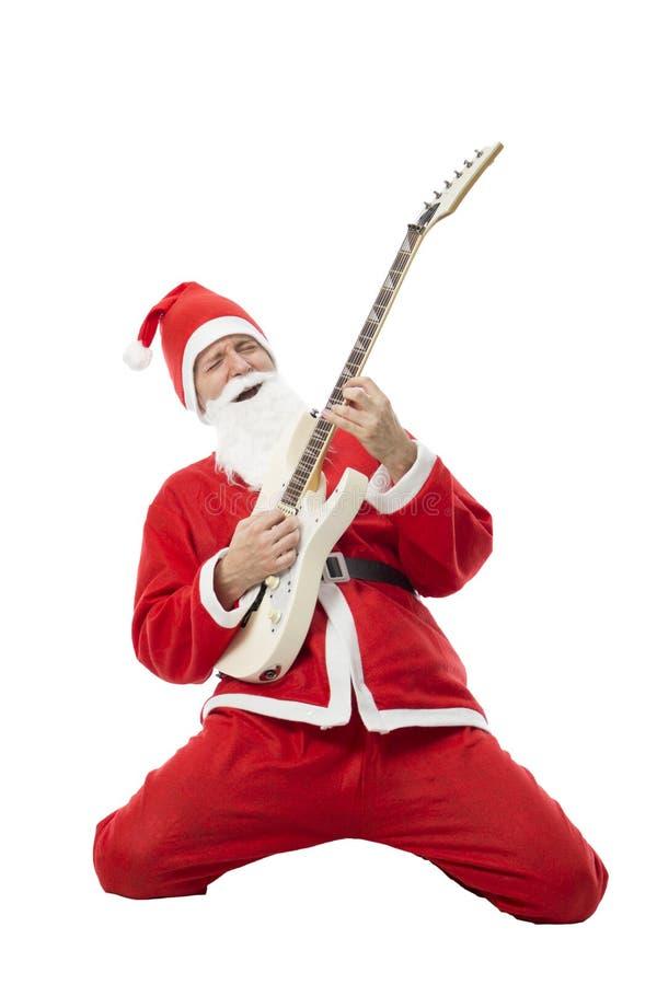 Guitarrista Santa Claus que joga uma guitarra elétrica fotografia de stock royalty free