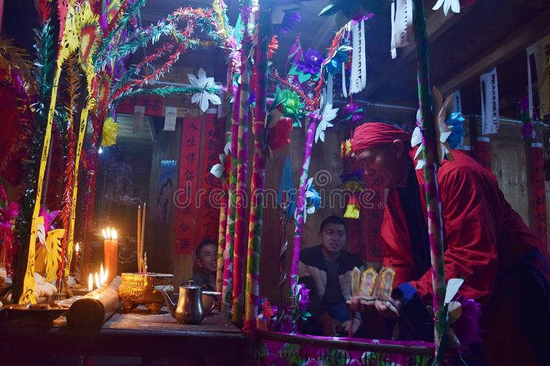 GUIZHOU PROVINCE, CHINA – CIRCA DECEMBER 2018: The ritual redeeming the vow. The ritual redeeming the vow`in a village of Guizhou accompanied by stock photo