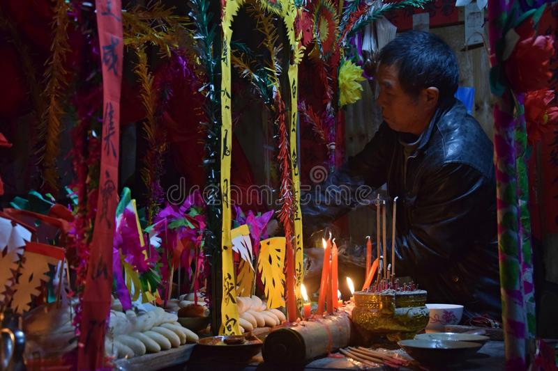 GUIZHOU PROVINCE, CHINA – CIRCA DECEMBER 2018: The ritual redeeming the vow. The ritual redeeming the vow`in a village of Guizhou accompanied by royalty free stock photography